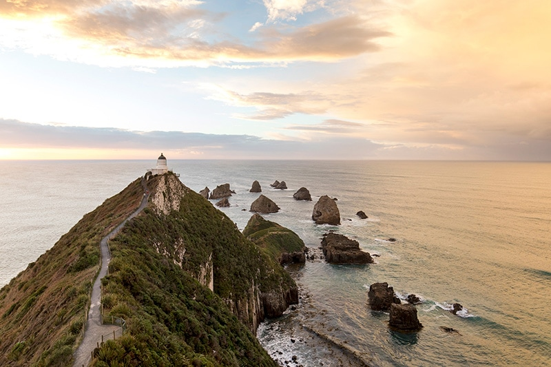 Sunset at Nugget Point lighthouse, The Catlins on a self drive tour